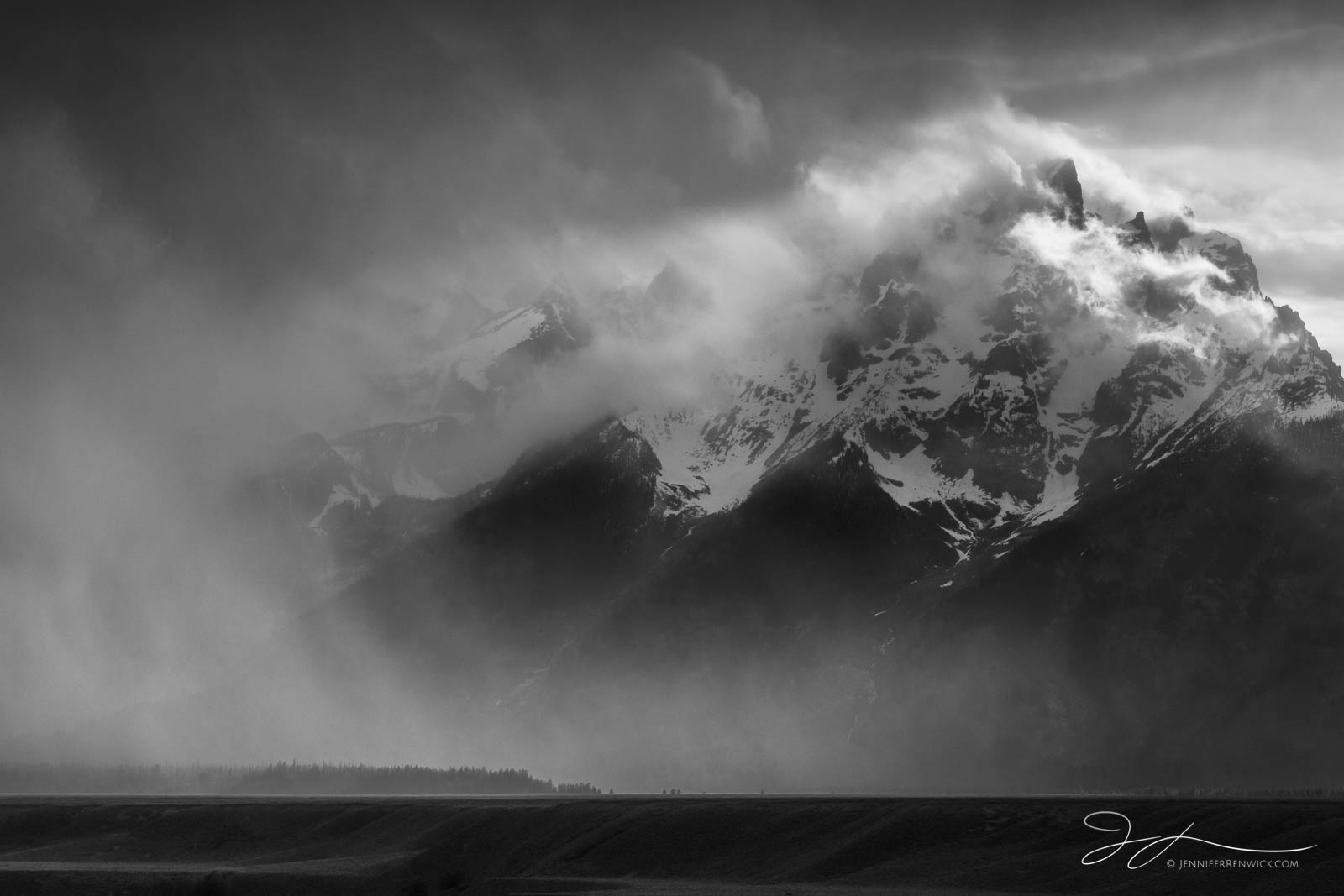 A storm clears and reveals the peaks of the Grand Tetons.