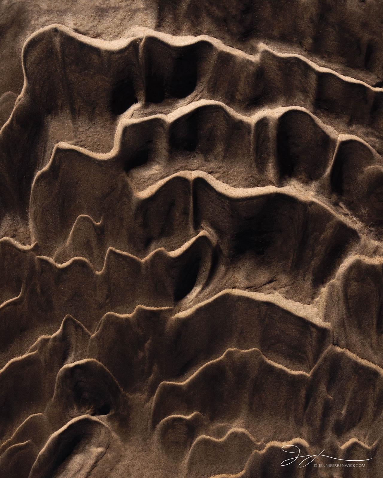 Desert sand ripples on the desert floor resemble corrugated cardboard.