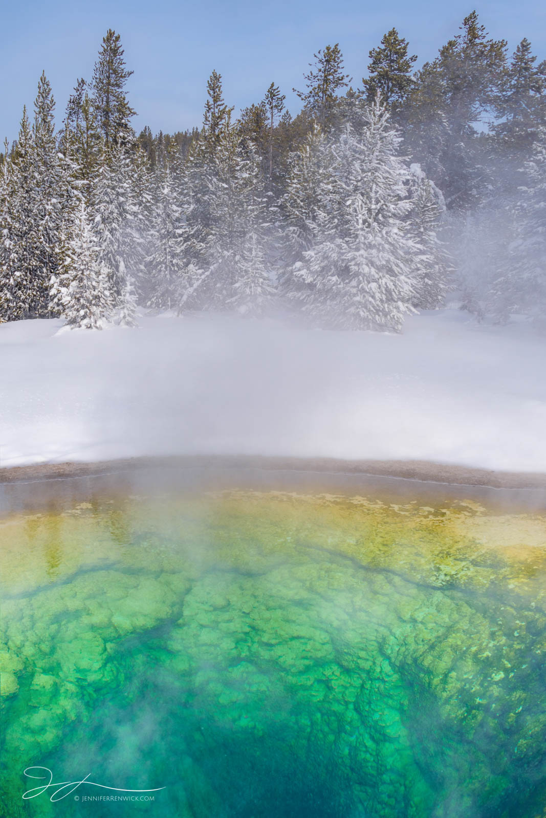 A hot spring in winter resembles a cross-section, seeming to reveal the underground of the landscape.