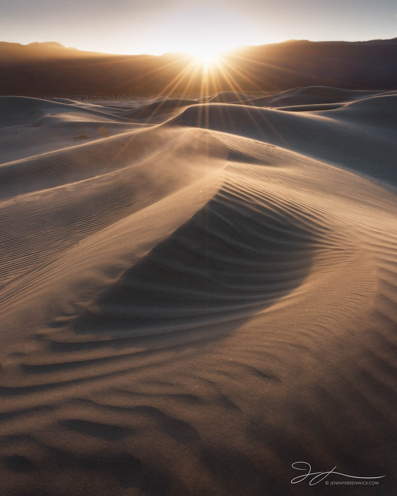 The sun sets over a remote dune field in Death Valley National Park.