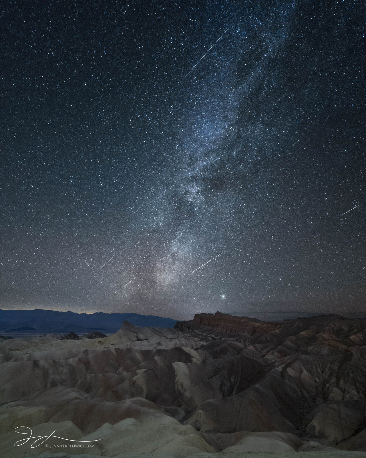 The Geminids Meteor shower puts on a display over Zabriskie Point in Death Valley National Park.  This image is a composite of...