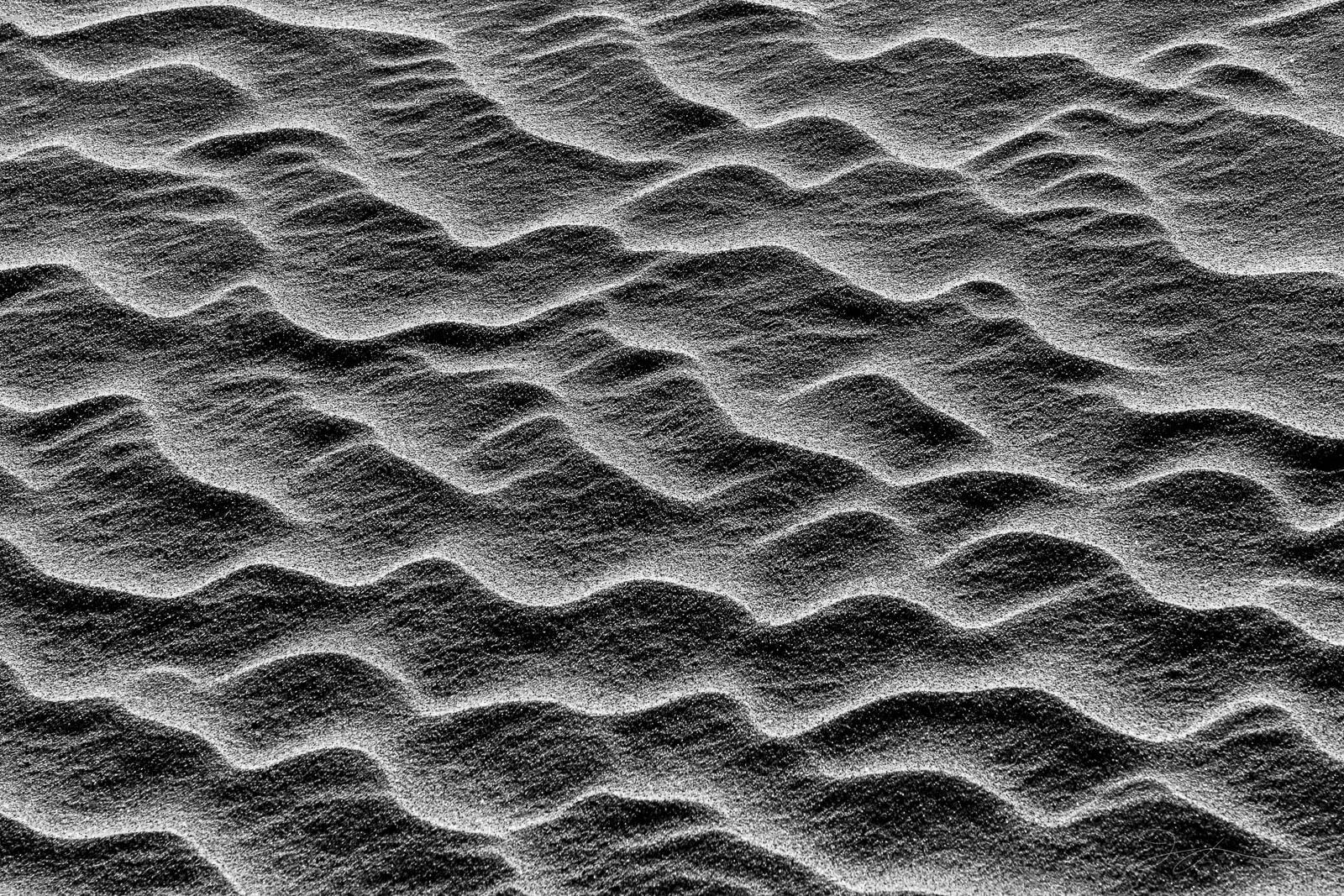 Sand patterns wave across the desert floor.