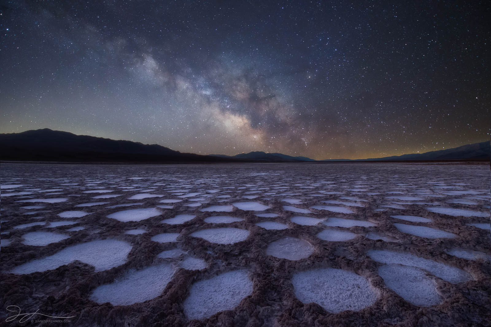 The Milky Way shines over alien formations in a playa in Death Valley National Park.