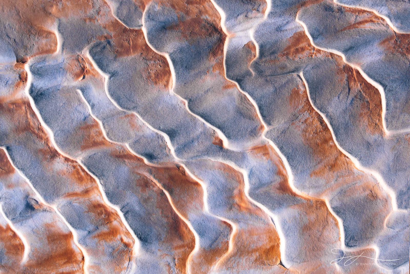 Sand ripples create a textured surface on the desert floor.