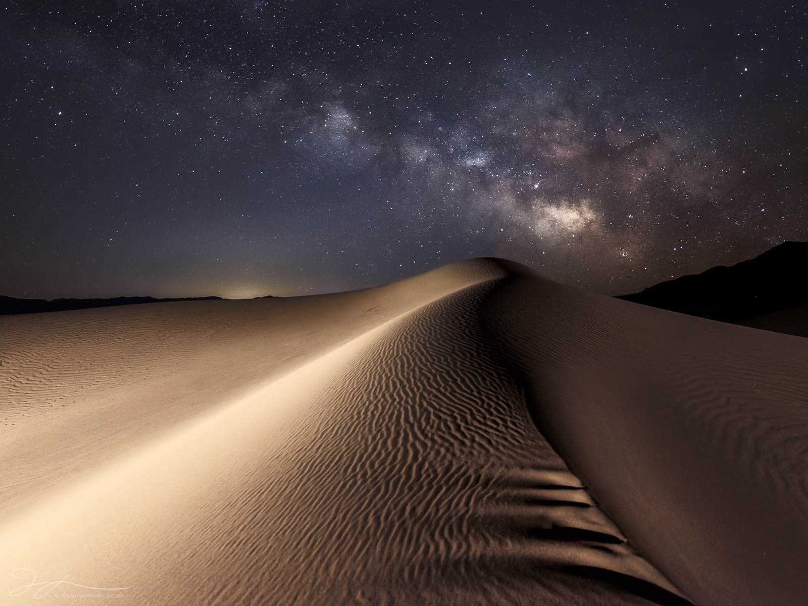 The Milky Way rises above the Mesquite Dunes in Death Valley National Park.