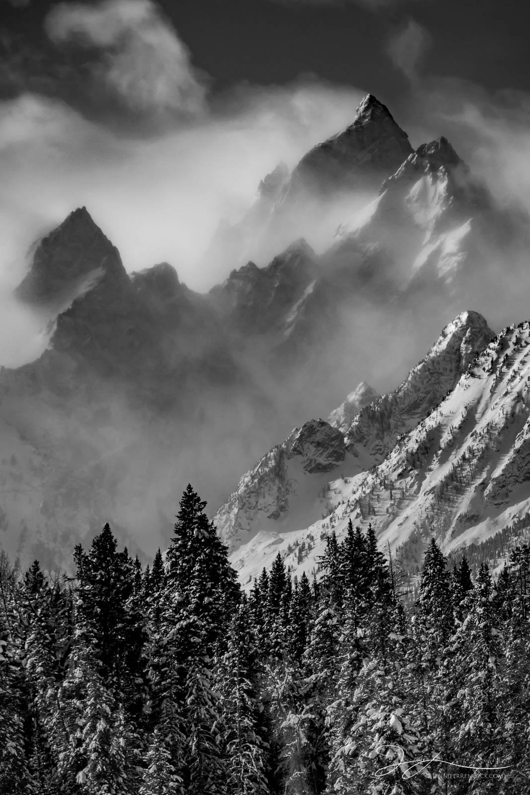 Winter winds and snow swirl around in the mountains making up the Teton Range.
