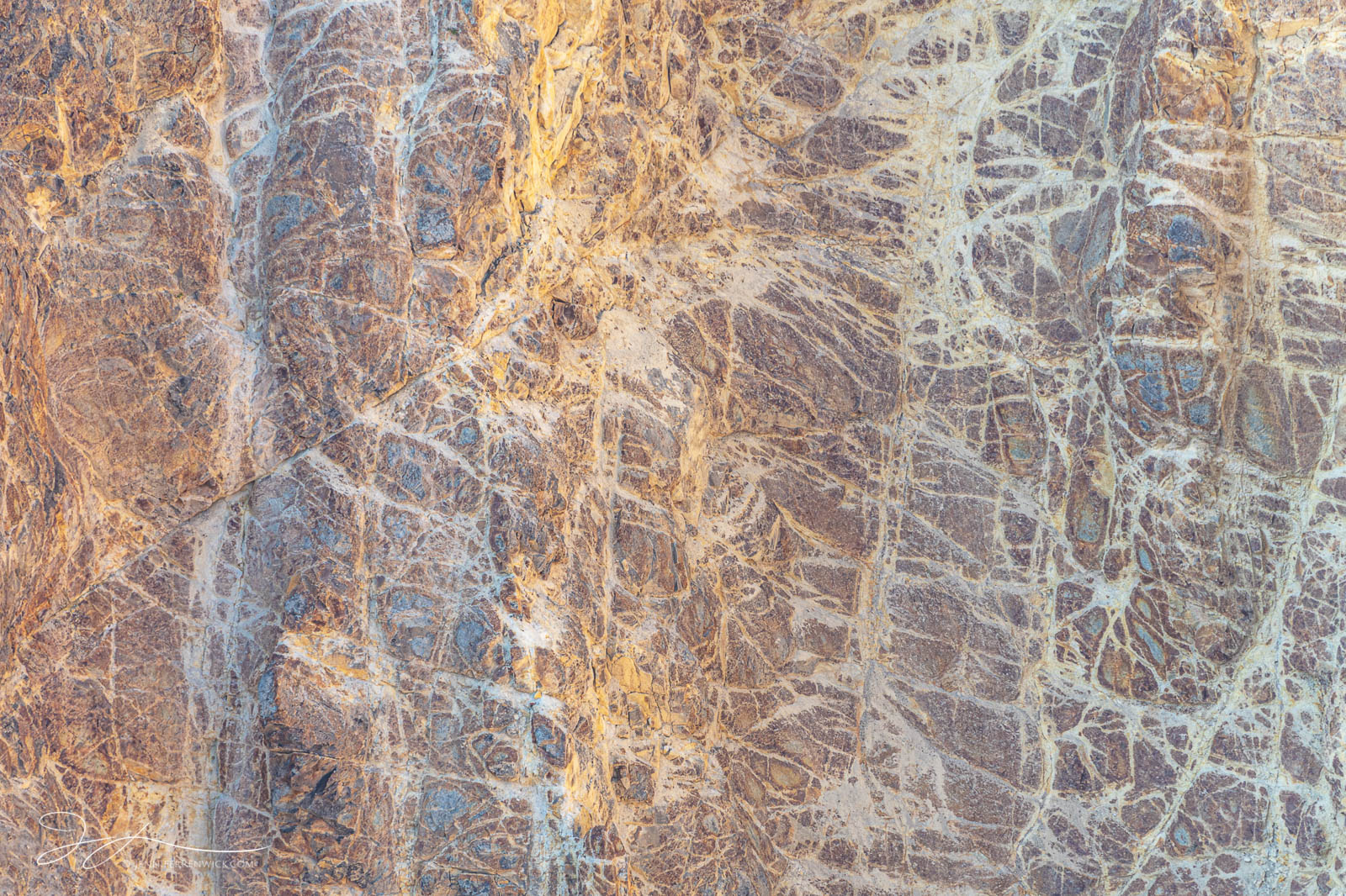 Fractures and patterns cut across the hydrothermally altered rhyolite walls of the Grand Canyon of the Yellowstone.